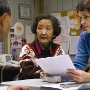 Asian woman with two office workers.